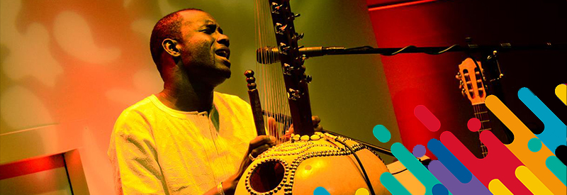 Photograph of Sura Susso playing Kora