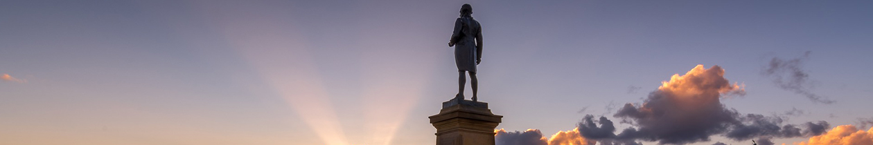 Captain Cook statue against a clear indigo coloured sky