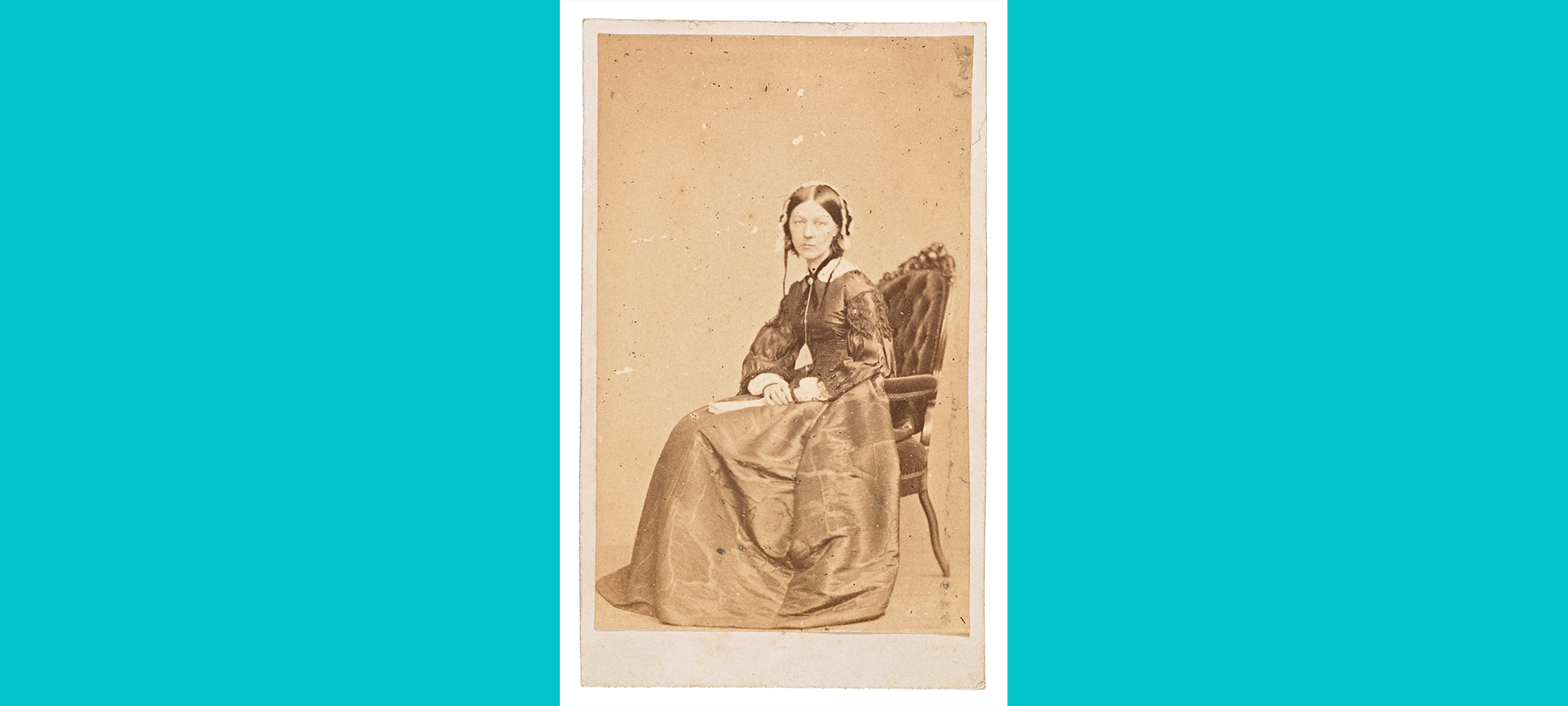 Florence Nightingale photographed seated with head turned at 90 degree angle