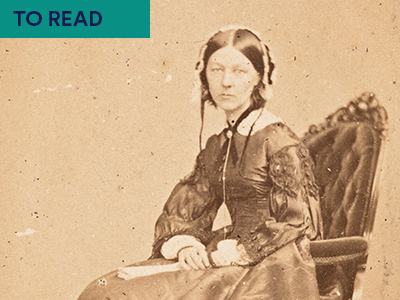 Photograph of Florence Nightingale in black and white sitting on a seat Keyword in top right corner TO READ