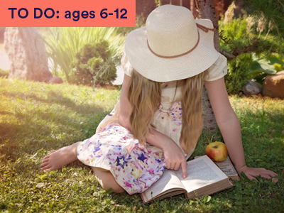 a little girl reading outdoors. Keyword in the corner FOR FAMILIES