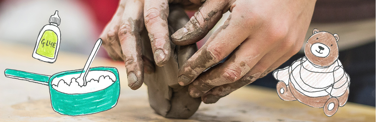 Child's hand playing with clay