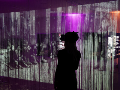 Eye as Witness exhibition visitor wearing VR headset