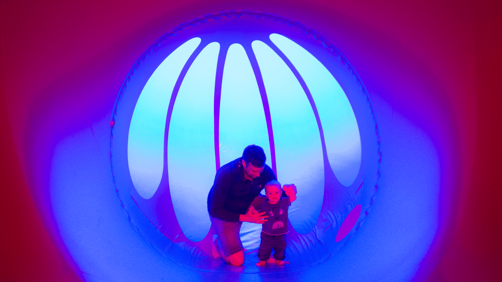 Parent and child in a luminarium at Lakeside Arts