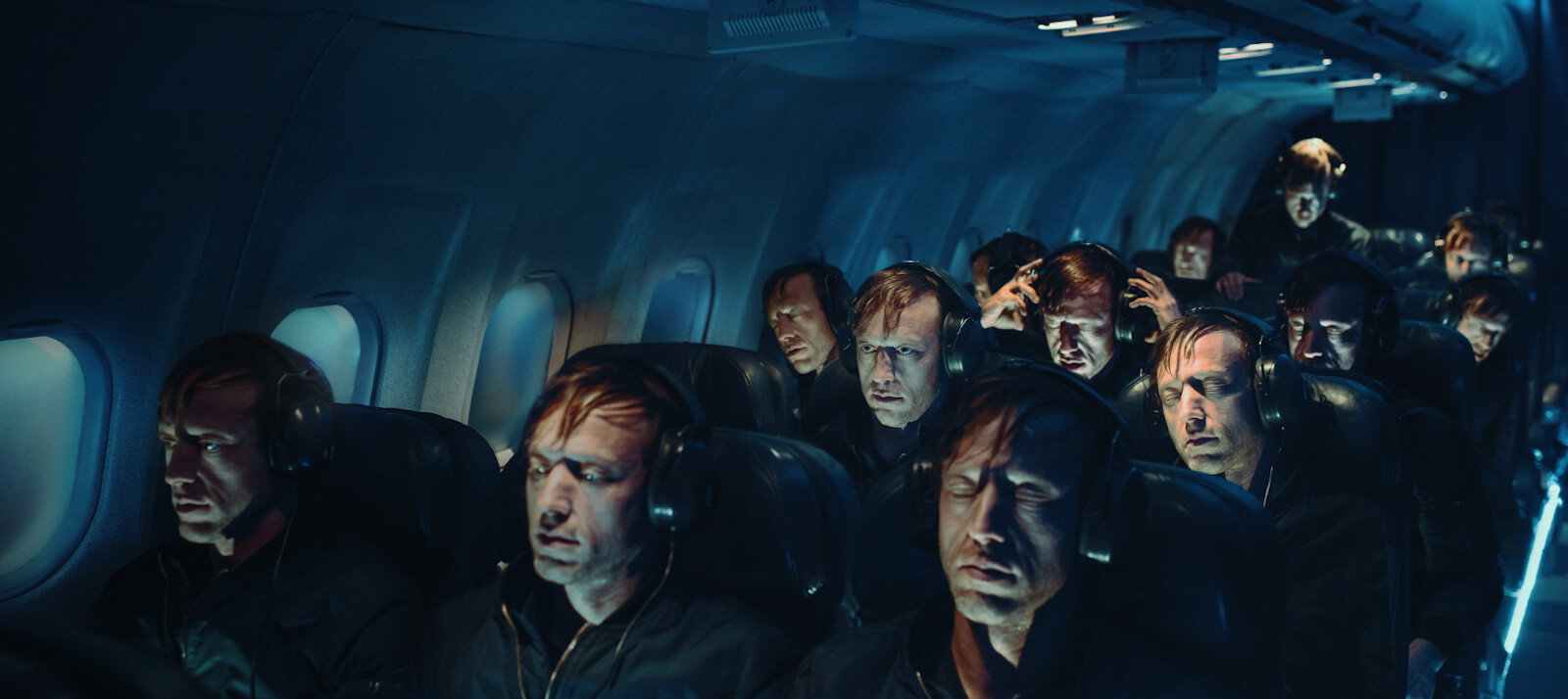 Flight promotional image of people sitting in an airplane