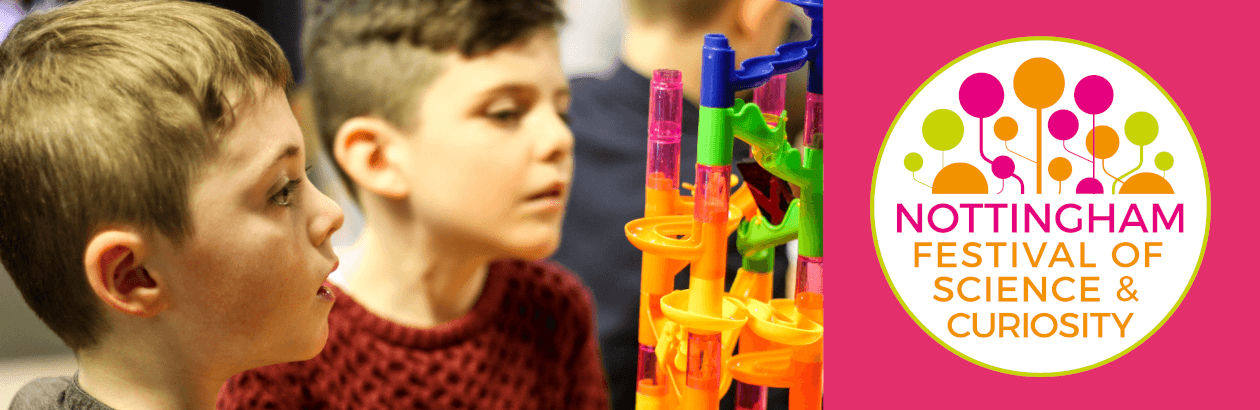 Two boys playing with a marble run and the Nottingham Festival of Science and Curiosity logo