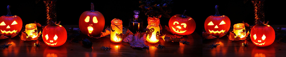 Halloween pumpkins with candle-lit jars in Halloween-themed display